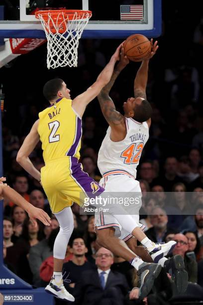 Lonzo Ball of the Los Angeles Lakers fouls Lance Thomas of the New York Knicks in the first half during their game at Madison Square Garden on...