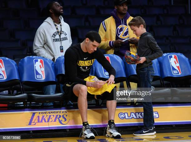 Lonzo Ball of the Los Angeles Lakers gives an autograph to a fan during pregame warm ups before the game against Dallas Mavericks at Staples Center...
