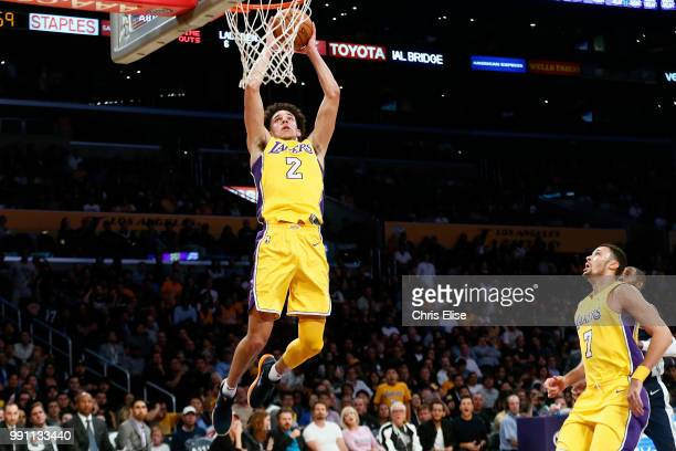 Lonzo Ball of the Los Angeles Lakers goes to the basket against the Denver Nuggets on October 2 2017 at the Staples Center in Los Angeles California...