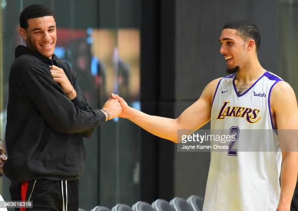 Lonzo Ball of the Los Angeles Lakers greets his brother LiAngelo Ball after he completed his NBA PreDraft Workout with the Los Angeles Lakers on May...