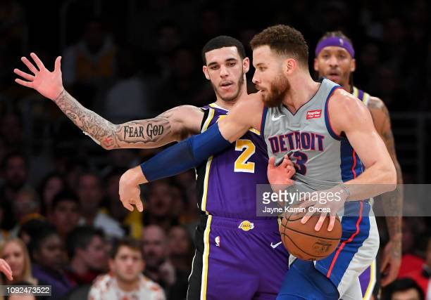 Lonzo Ball of the Los Angeles Lakers guards Blake Griffin of the Detroit Pistons as he drives to the basket in the game at Staples Center on January...