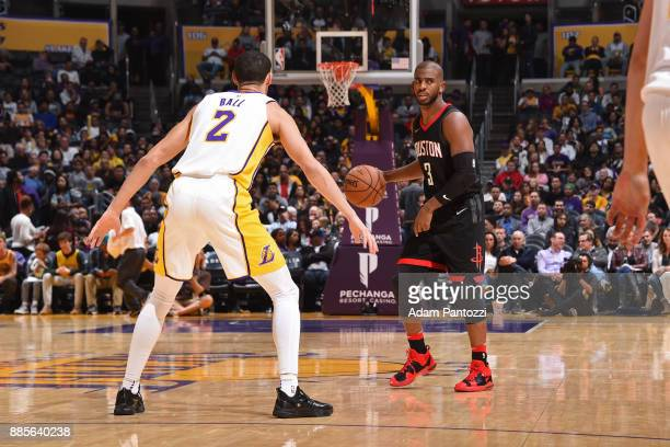 Lonzo Ball of the Los Angeles Lakers guards Chris Paul of the Houston Rockets on December 3 2017 at STAPLES Center in Los Angeles California NOTE TO...