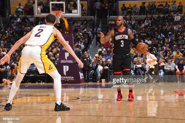 Lonzo Ball of the Los Angeles Lakers guards Lonzo Ball of the Los Angeles Lakers on December 3 2017 at STAPLES Center in Los Angeles California NOTE...