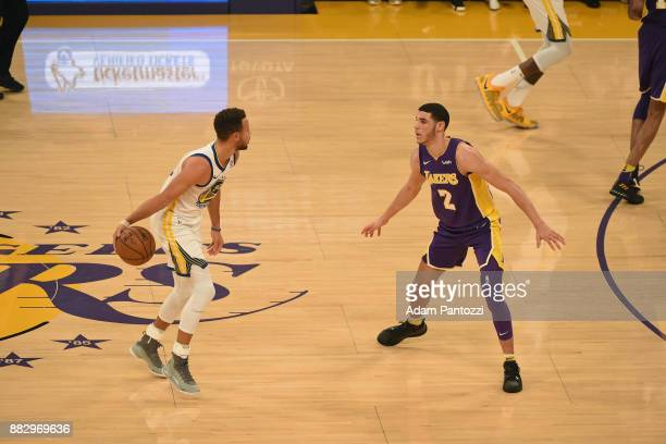 Lonzo Ball of the Los Angeles Lakers guards Stephen Curry of the Golden State Warriors on November 29 2017 at STAPLES Center in Los Angeles...
