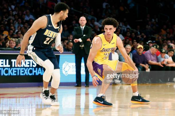 Lonzo Ball of the Los Angeles Lakers handles the ball against Jamal Murray of the Denver Nuggets on October 2 2017 at the Staples Center in Los...