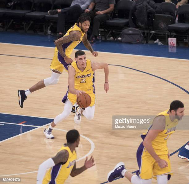 Lonzo Ball of the Los Angeles Lakers handles the ball between his teammates during the second half of the game against the New York Knicks at Madison...