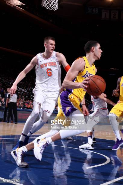Lonzo Ball of the Los Angeles Lakers handles the ball during overtime against the New York Knicks on December 12 2017 at Madison Square Garden in New...