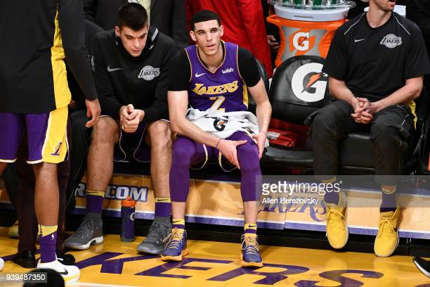 Lonzo Ball of the Los Angeles Lakers holds a sore knee during the second half of a basketball game against the Dallas Mavericks at Staples Center on...