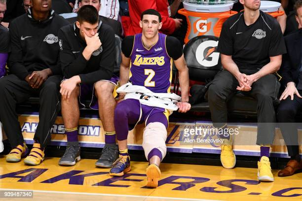 Lonzo Ball of the Los Angeles Lakers ices a sore knee during the second half of a basketball game against the Dallas Mavericks at Staples Center on...