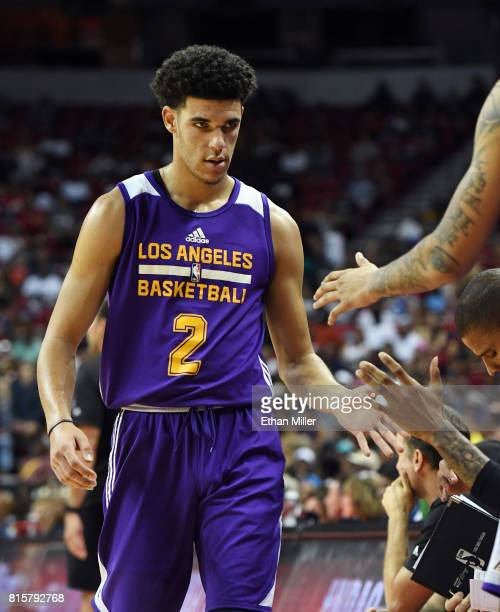 Lonzo Ball of the Los Angeles Lakers is congratulated by teammates as he walks to the bench during a semifinal game of the 2017 Summer League against...