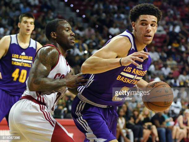 Lonzo Ball of the Los Angeles Lakers is guarded by Kay Felder of the Cleveland Cavaliers during the 2017 Summer League at the Thomas Mack Center on...