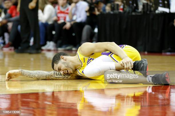 Lonzo Ball of the Los Angeles Lakers lays on the court after an injury in the second half against the Houston Rockets at Toyota Center on January 19...