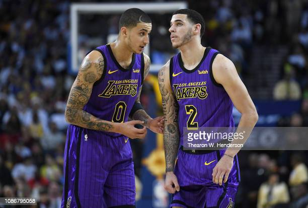 Lonzo Ball of the Los Angeles Lakers listens to teammate Kyle Kuzma against the Golden State Warriors during the second half of their NBA Basketball...