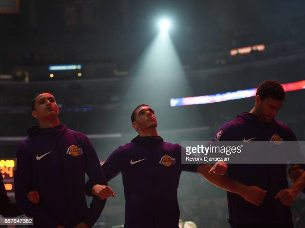 Lonzo Ball of the Los Angeles Lakers locks arms with teammates during national anthem before the start of a basketball game against Houston Rockets...