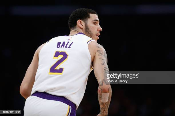 Lonzo Ball of the Los Angeles Lakers looks on after taking a shot during the first half of a game against the Cleveland Cavaliers at Staples Center...
