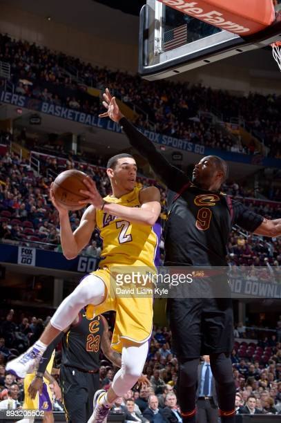 Lonzo Ball of the Los Angeles Lakers looks to pass against the Cleveland Cavaliers on December 14 2017 at Quicken Loans Arena in Cleveland Ohio NOTE...