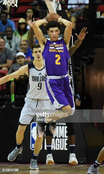 Lonzo Ball of the Los Angeles Lakers looks to pass in front of Nicolas Brussino of the Dallas Mavericks during a semifinal game of the 2017 Summer...