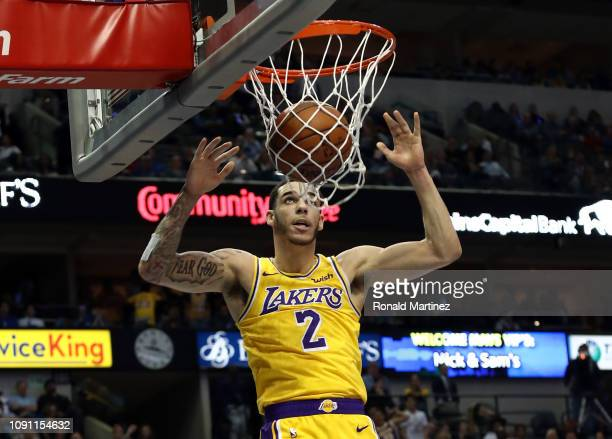 Lonzo Ball of the Los Angeles Lakers makes the slam dunk against the Dallas Mavericks at American Airlines Center on January 07 2019 in Dallas Texas...