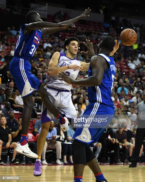 Lonzo Ball of the Los Angeles Lakers passes against Brandon Austin and Alex Poythress of the Philadelphia 76ers during the 2017 Summer League at the...