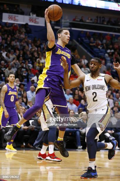 Lonzo Ball of the Los Angeles Lakers passes as Ian Clark of the New Orleans Pelicans defends during the second half at the Smoothie King Center on...