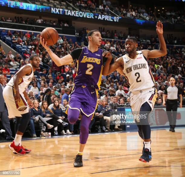 Lonzo Ball of the Los Angeles Lakers passes the ball against Ian Clark of the New Orleans Pelicans on March 22 2018 at Smoothie King Center in New...