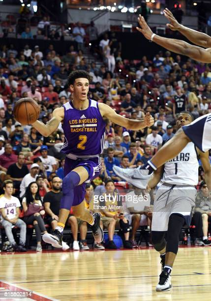 Lonzo Ball of the Los Angeles Lakers passes the ball under the basket against the Dallas Mavericks during a semifinal game of the 2017 Summer League...