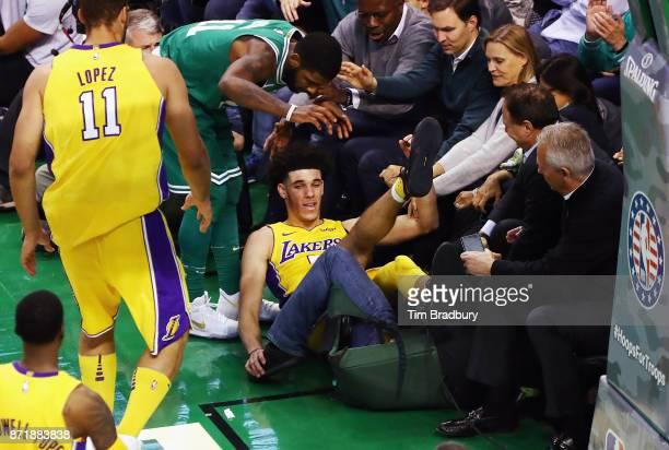 Lonzo Ball of the Los Angeles Lakers reacts after falling into fans during the fourth quarter against the Boston Celtics at TD Garden on November 8,...