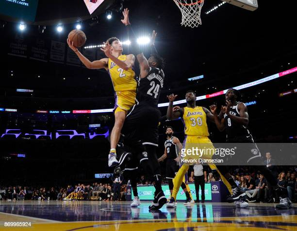 Lonzo Ball of the Los Angeles Lakers scores a basket against Rondae HollisJefferson of the Brooklyn Nets during half of the basketball game at...