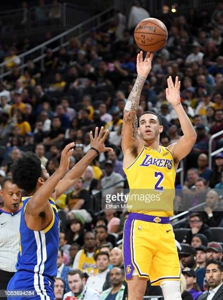 Lonzo Ball of the Los Angeles Lakers shoots against Quinn Cook of the Golden State Warriors during their preseason game at TMobile Arena on October...