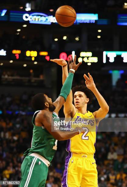 Lonzo Ball of the Los Angeles Lakers shoots the ball against Kyrie Irving of the Boston Celtics during the first quarter at TD Garden on November 8...