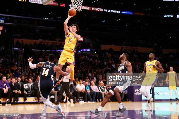 Lonzo Ball of the Los Angeles Lakers shoots the ball against the Denver Nuggets on October 2 2017 at the Staples Center in Los Angeles California USA...