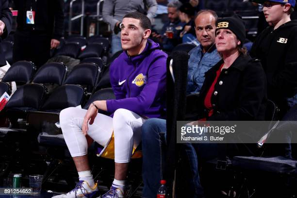 Lonzo Ball of the Los Angeles Lakers sits with his mother Tina Ball during halftime of the game against the New York Knicks on December 12 2017 at...
