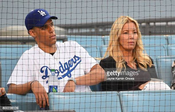 Lonzo Ball of the Los Angeles Lakers sits with team owner Jeannie Buss during the game between the Los Angeles Dodgers and the Colorado Rockies at...