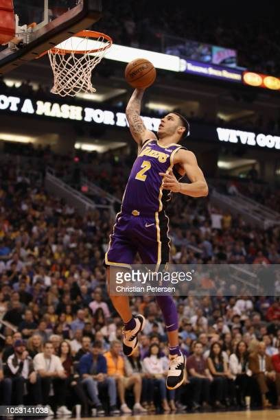 Lonzo Ball of the Los Angeles Lakers slam dunks the ball against the Phoenix Suns during the first half of the NBA game at Talking Stick Resort Arena...