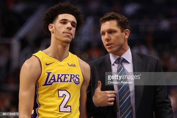 Lonzo Ball of the Los Angeles Lakers talks with head coach Luke Walkton during the first half of the NBA game against the Phoenix Suns at Talking...