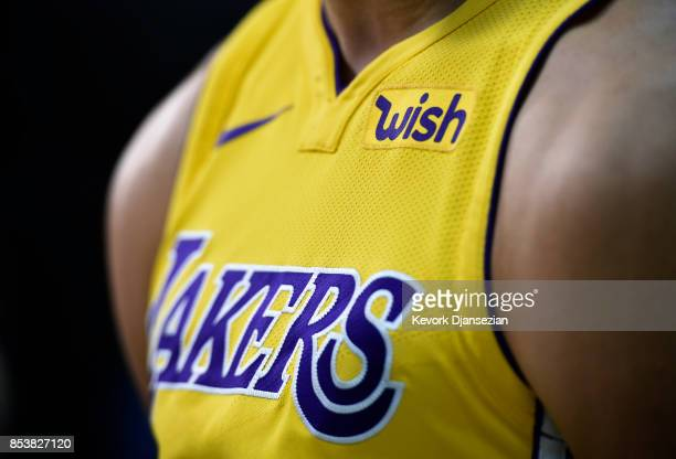 Lonzo Ball of the Los Angeles Lakers wears his new Nike jersey with the sponsor's logo 'Wish' on the left chests during media day September 25 in El...