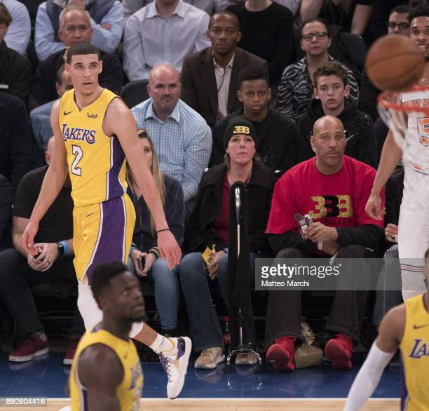 Lonzo Ball of the Los Angeles Lakers with his father LaVar Ball and his mother Tina Ball during the game against the New York Knicks at Madison...