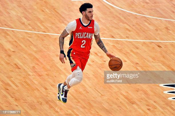 Lonzo Ball of the New Orleans Pelicans brings the ball up court during the second half against the Memphis Grizzlies at FedExForum on May 10, 2021 in...