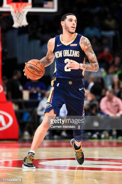 Lonzo Ball of the New Orleans Pelicans brings the ball upcourt during the first quarter of a preseason game against the Atlanta Hawks at State Farm...