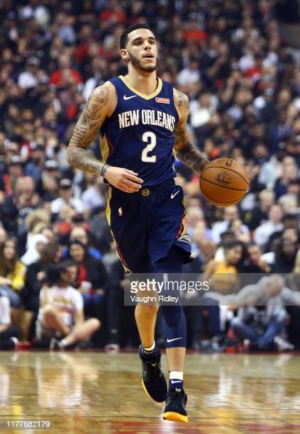 Lonzo Ball of the New Orleans Pelicans dribbles the ball during the first half of an NBA game against the Toronto Raptors at Scotiabank Arena on...
