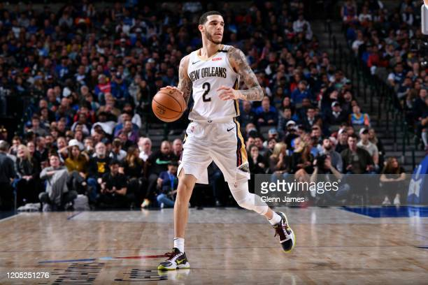 Lonzo Ball of the New Orleans Pelicans handles the ball against the Dallas Mavericks on March 4, 2020 at the American Airlines Center in Dallas,...