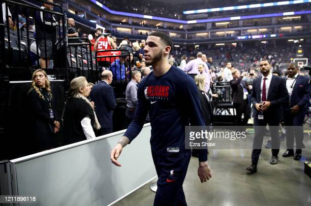Lonzo Ball of the New Orleans Pelicans leaves the court after their game against the Sacramento Kings was postponed due to the corona virus at Golden...