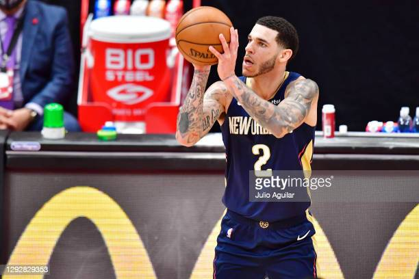 Lonzo Ball of the New Orleans Pelicans shoots from beyond the three point line during the second half against the Toronto Raptors at Amalie Arena on...