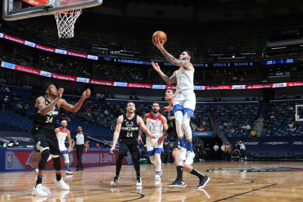 Lonzo Ball of the New Orleans Pelicans shoots the ball during the game against the Milwaukee Bucks on January 29, 2021 at the Smoothie King Center in...