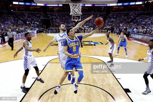 Lonzo Ball of the UCLA Bruins drives to the basket against Isaac Humphries of the Kentucky Wildcats in the first half during the 2017 NCAA Men's...