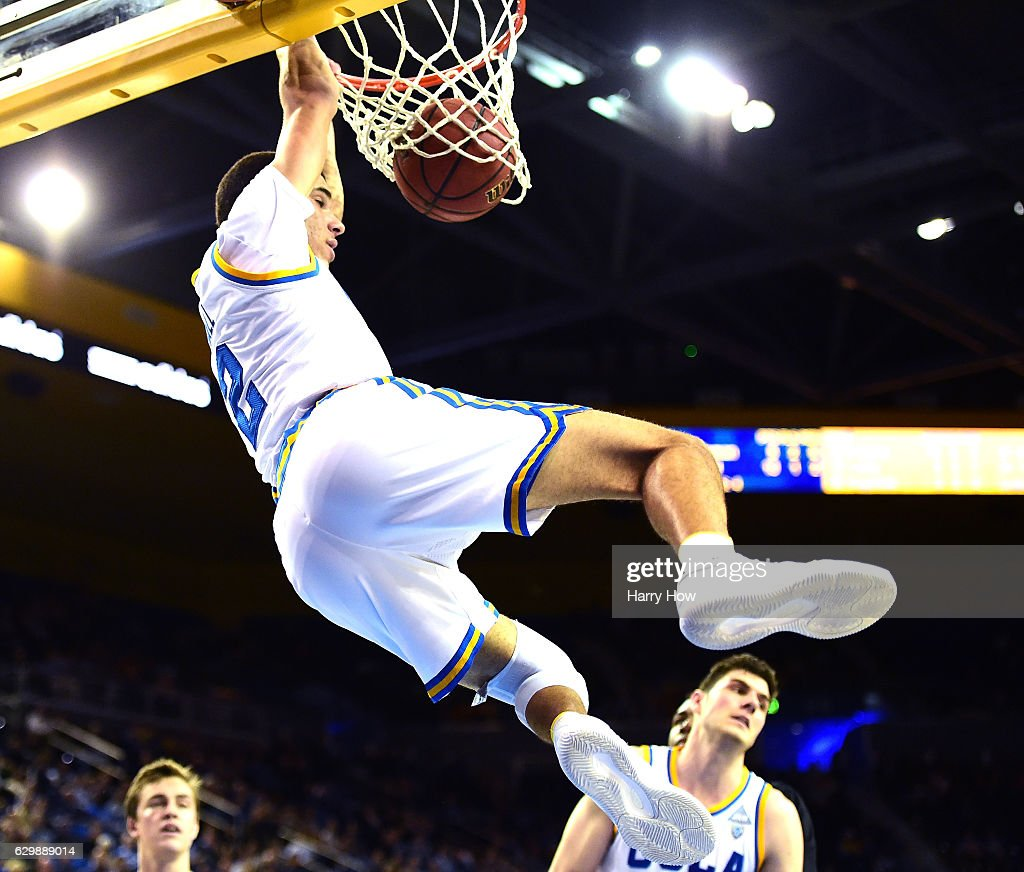 Lonzo Ball #2 of the UCLA Bruins dunks in front of Gyorgy Goloman #14 as Maxwell Kupchak #10 of the UC Santa Barbara Gauchos looks on during a 102-62 win over the UC Santa Barbara Gauchos at Pauley Pavilion on December 14, 2016 in Los Angeles, California.