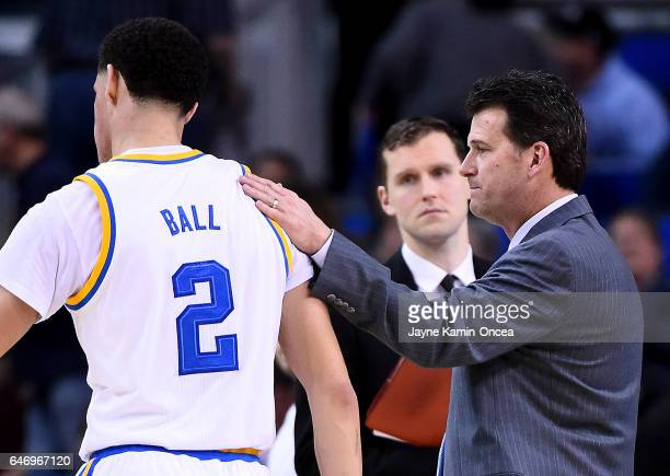 Lonzo Ball of the UCLA Bruins gets a pat on the back from head coach head coach Steve Alford as he leaves the second half of the game against the...