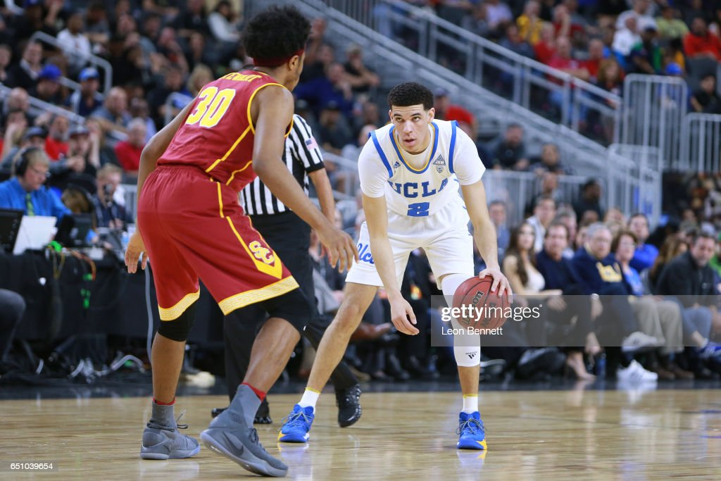 Lonzo Ball #2 of the UCLA Bruins handles the ball against Elijah Stewart #30 of the USC Trojans during a quarterfinal game of the Pac-12 Basketball Tournament at T-Mobile Arena on March 9, 2017 in Las Vegas, Nevada. UCLA won 76-74.