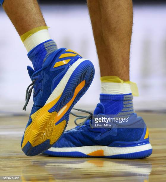 Lonzo Ball of the UCLA Bruins wears adidas sneakers during a semifinal game of the Pac12 Basketball Tournament against the Arizona Wildcats at...