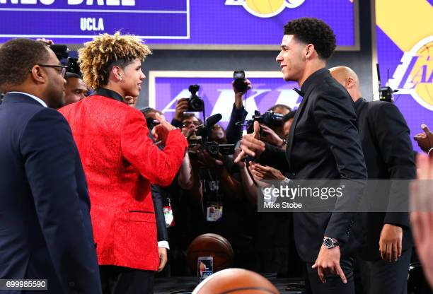 Lonzo Ball reacts with his brother LaMelo Ball after being drafted second overall by the Los Angeles Lakers during the first round of the 2017 NBA...